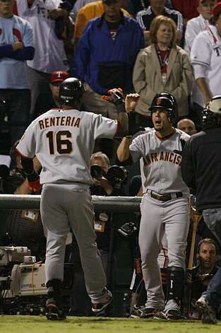 San Francisco Giants shortstop Edgar Renteria is greeted at the dugout after hitting a three-run home run in the seventh inning of Game 5 of the World Series against the Texas Rangers on Monday. Photo: Lance Iversen, San Francisco Chronicle