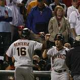 San Francisco Giants shortstop Edgar Renteria is greeted at the dugout after hitting a three-run home run in the seventh inning of Game 5 of the World Series against the Texas Rangers on Monday.
