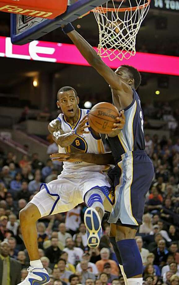 The Golden State Warriors Monta Ellis is fouled by  Hasheem Thabeet of the Memphis Grizzlies in the first period at the Oracle Coliseum, Wednesday Nov. 3, 2010, in Oakland, Calif. Photo: Lacy Atkins, The Chronicle