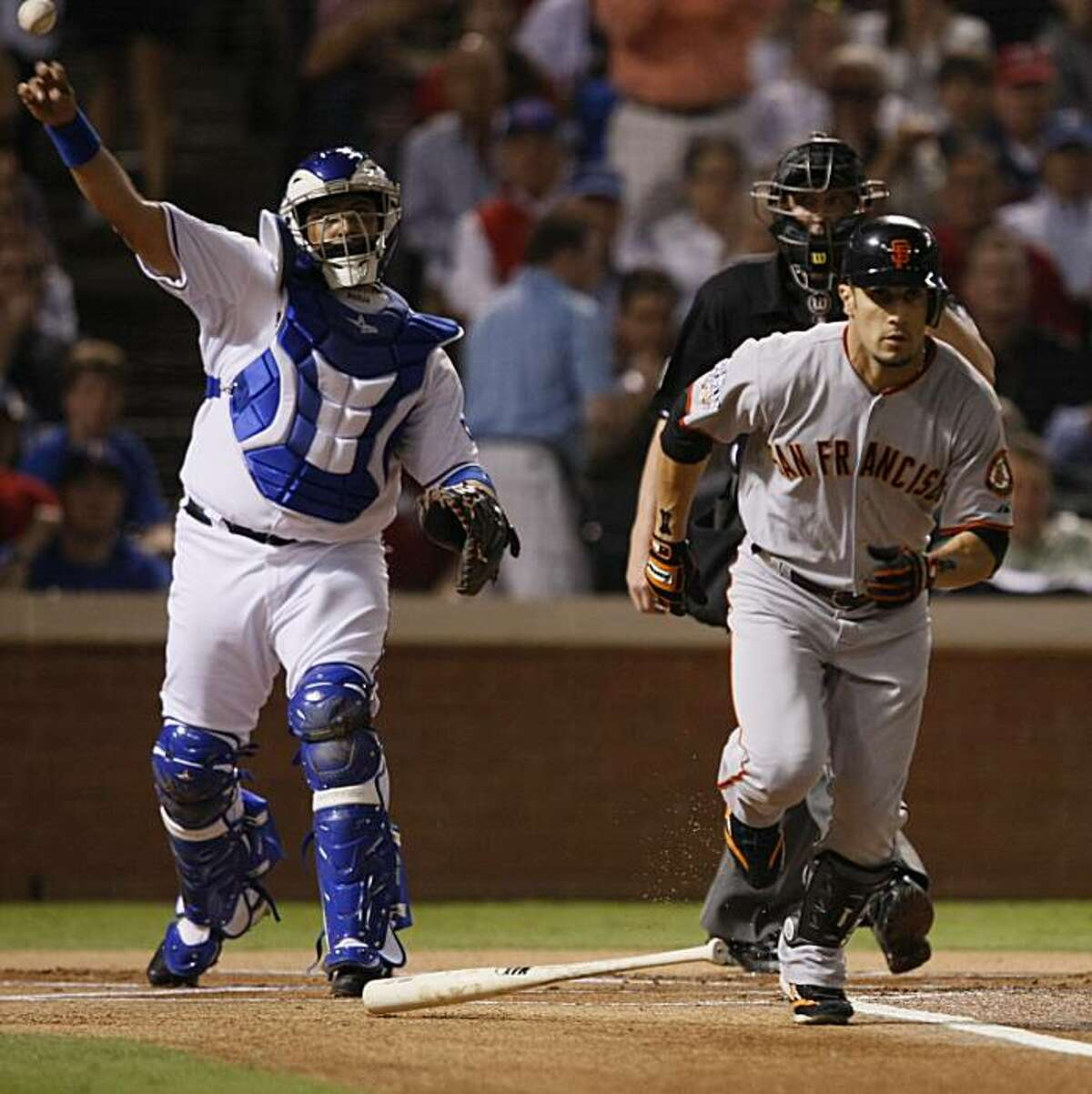 Texas Rangers catcher Bengie Molina throws the ball to first to get the out on San Francisco Giants right fielder Andres Torres in the first inning of Game 5 of the World Series on Monday.