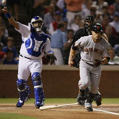 Texas Rangers catcher Bengie Molina throws the ball to first to get the out on San Francisco Giants right fielder Andres Torres in the first inning of Game 5 of the World Series on Monday. Photo: Lance Iversen, San Francisco Chronicle