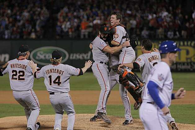 Buster Posey jumps into Brian Wilson's arms as the San Francisco Giants take Game 5 to win the World Series over the Texas Rangers on Monday. Photo: Michael Macor, San Francisco Chronicle