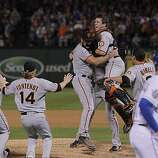 Buster Posey jumps into Brian Wilson's arms as the San Francisco Giants take Game 5 to win the World Series over the Texas Rangers on Monday.
