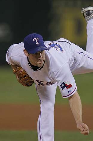 Texas Rangers starting pitcher Cliff Lee (33) completes his follow through in the first inning of Game 5 of the World Series against the San Francisco Giants on Monday. Photo: Michael Macor, San Francisco Chronicle