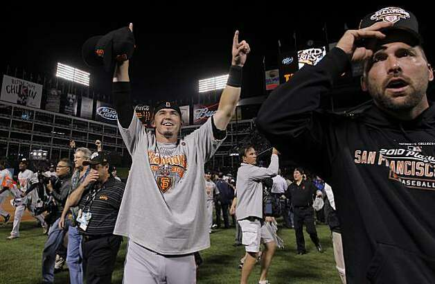 Eli Whiteside, center, celebrates as the San Francisco Giants take Game 5 to win the World Series over the Texas Rangers on Monday. Photo: Michael Macor, San Francisco Chronicle