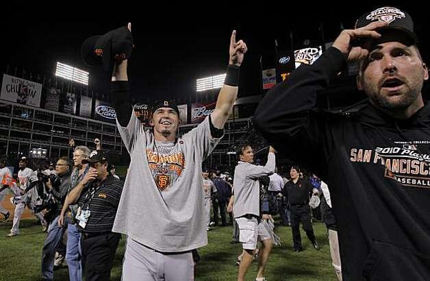 Eli Whiteside, center, celebrates as the San Francisco Giants take Game 5 to win the World Series over the Texas Rangers on Monday. Photo: Michael Macor, San Francisco Chronicle