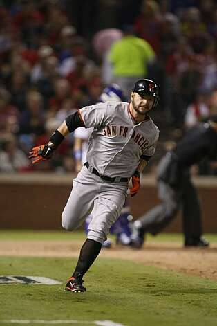 San Francisco Giants center fielder Cody Ross gets a base hit in the seventh inning of Game 5 of the World Series against the Texas Rangers on Monday. Photo: Lance Iversen, San Francisco Chronicle