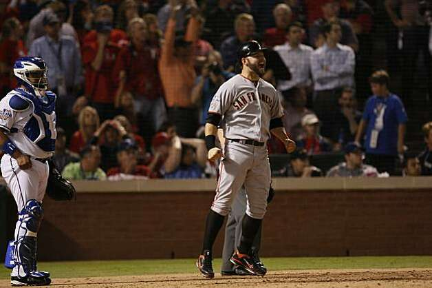 San Francisco Giants center fielder Cody Ross celebrates as he scores on Edgar Renteria's three-run home run in the seventh inning of Game 5 of the World Series against the Texas Rangers on Monday. Photo: Lance Iversen, San Francisco Chronicle