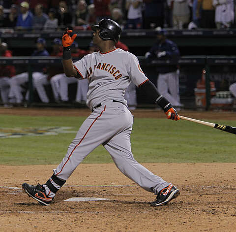 San Francisco Giants shortstop Edgar Renteria (16) watches his seventh inning three-run home run during game 5 of the 2010 World Series between the San Francisco Giants and the Texas Rangers on Monday, Nov. 1, 2010 in Arlington, Tx. Photo: Michael Macor, San Francisco Chronicle