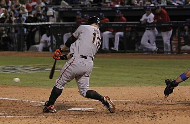 San Francisco Giants center fielder Cody Ross hits a single in the seventh inning of Game 5 of the World Series against the Texas Rangers on Monday. Photo: Michael Macor, San Francisco Chronicle