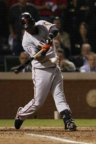 San Francisco Giants shortstop Edgar Renteria hits a three-run home run in the seventh inning of Game 5 of the World Series against the Texas Rangers on Monday. Photo: Lance Iversen, San Francisco Chronicle