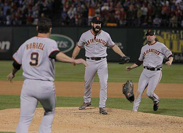 Brian Wilson celebrates after striking out Nelson Cruz to end Game 5 and win the World Series over the Texas Rangers on Monday. Photo: Michael Macor, San Francisco Chronicle