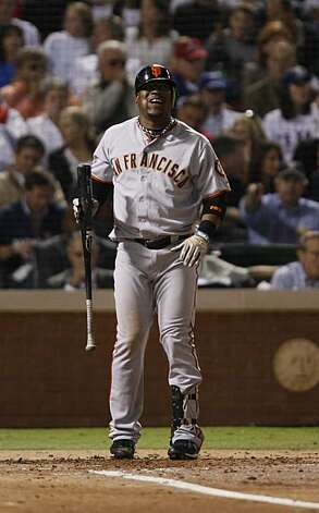 San Francisco Giants shortstop Juan Uribe shows his frustration at bat before striking out in the second inning of Game 5 of the World Series against the Texas Rangers on Monday. Photo: Lance Iversen, San Francisco Chronicle