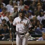 San Francisco Giants shortstop Juan Uribe shows his frustration at bat before striking out in the second inning of Game 5 of the World Series against the Texas Rangers on Monday.