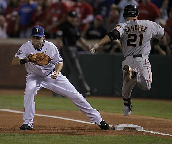 Texas Rangers first baseman Mitch Moreland (18) makes the out on San Francisco Giants second baseman Freddy Sanchez (21) in the first inning of Game 5 of the World Series on Monday. Photo: Michael Macor, San Francisco Chronicle