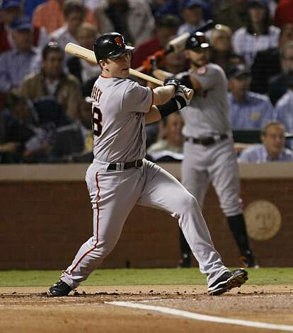 San Francisco Giants catcher Buster Posey singles in the first inning of Game 5 of the World Series against the Texas Rangers on Monday. Photo: Lance Iversen, San Francisco Chronicle