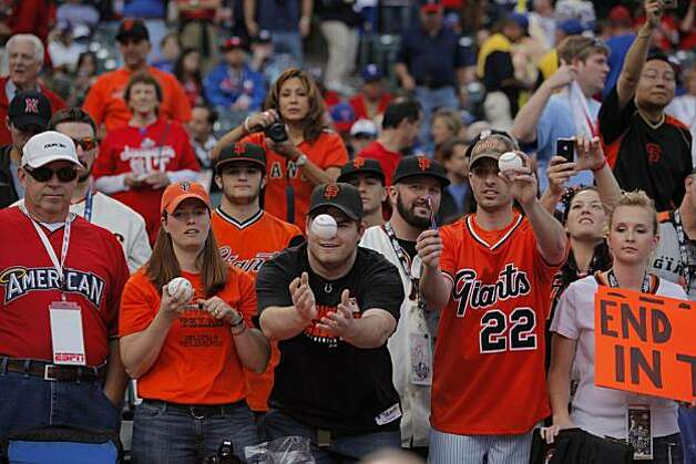 Giants fan T. J. Gillette of Oklahoma gets a ball prior to Game 5 of the World Series against the Texas Rangers on Monday. Photo: Michael Macor, San Francisco Chronicle