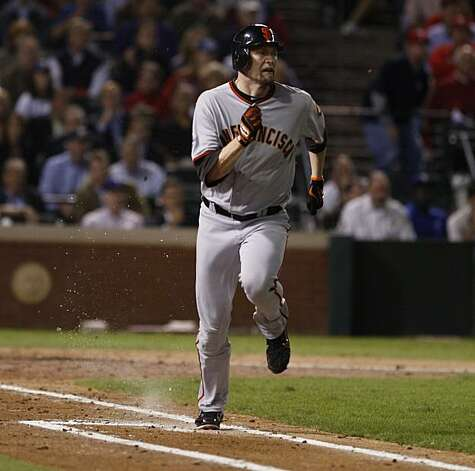 San Francisco Giants first baseman Aubrey Huff gets a single in the fifth inning of Game 5 of the World Series against the Texas Rangers on Monday. Photo: Lance Iversen, San Francisco Chronicle