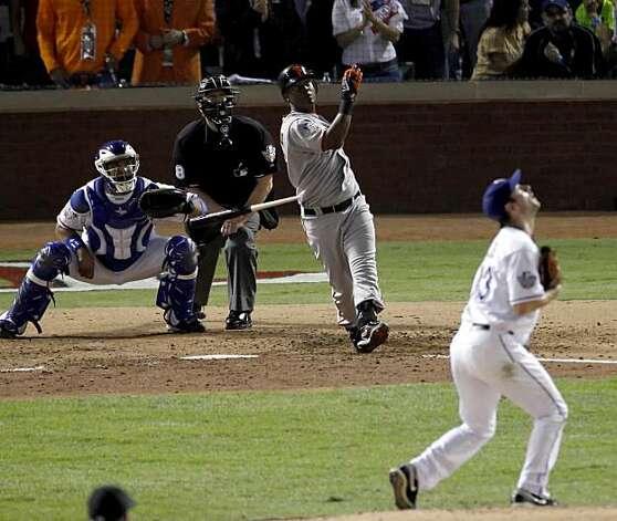San Francisco Giants shortstop Edgar Renteria (16) watches his three-run home run in the seventh inning during game 5 of the 2010 World Series between the San Francisco Giants and the Texas Rangers on Monday, Nov. 1, 2010 in Arlington, Tx. Photo: Carlos Avila Gonzalez, San Francisco Chronicle