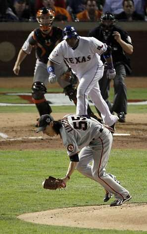San Francisco Giants starting pitcher Tim Lincecum (55) fields a Bengie Molina hit to end the fifth inning during game 5 of the 2010 World Series between the San Francisco Giants and the Texas Rangers on Monday, Nov. 1, 2010 in Arlington, Tx. Photo: Carlos Avila Gonzalez, San Francisco Chronicle