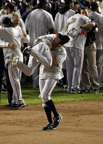 Nate Schierholz picks up Sergio Romo as the Giants celebrate on the field after winning the final game of the World Series. The San Francisco Giants defeated the Texas Rangers 3-1 in Game 5 of the World Series at Rangers Ballpark in Arlington, Tx, on Monday, November 1, 2010. Photo: Carlos Avila Gonzalez, San Francisco Chronicle
