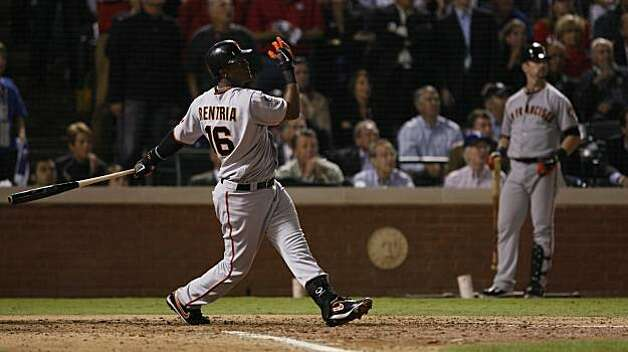 San Francisco Giants shortstop Edgar Renteria watches his seventh inning three-run home run in Game 5 of the World Series against the Texas Rangers on Monday. Photo: Lance Iversen, San Francisco Chronicle