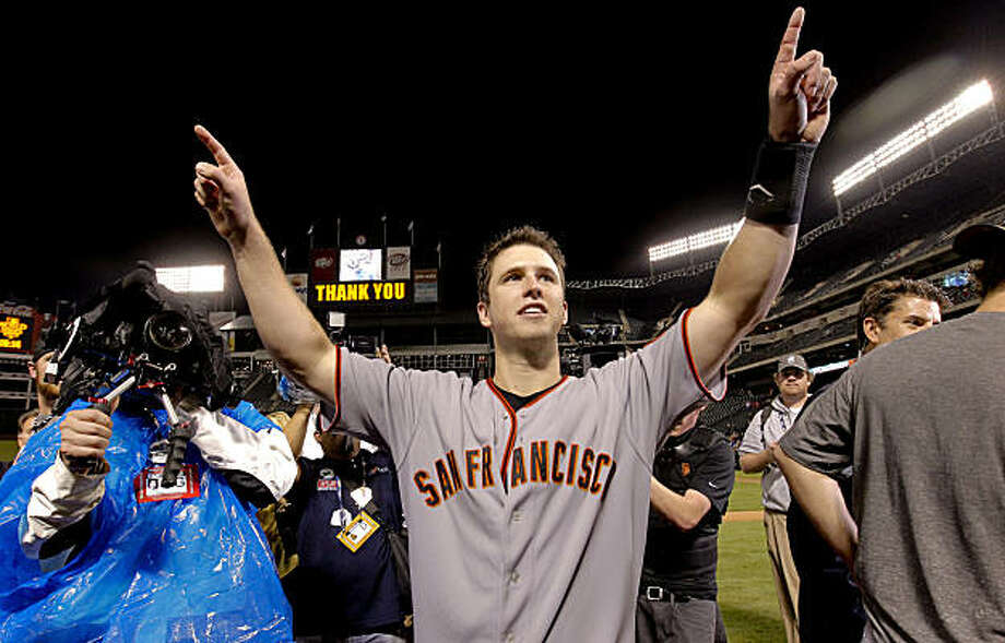 Giants Buster Posey parades around the field waving to fans following San Francisco's win of the 2010 World Series over the Texas Rangers on Monday Nov. 1, 2010 in Arlington, Tx., with a score of 3-1. Photo: Michael Macor, San Francisco Chronicle