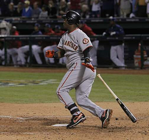 San Francisco Giants shortstop Edgar Renteria watches his seventh inning three-run home run in Game 5 of the World Series against the Texas Rangers on Monday. Photo: Michael Macor, San Francisco Chronicle