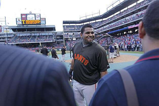 San Francisco Giants third baseman Pablo Sandoval (48) jokes with the media prior to Game 5 of the World Series against the Texas Rangers on Monday. Photo: Michael Macor, San Francisco Chronicle