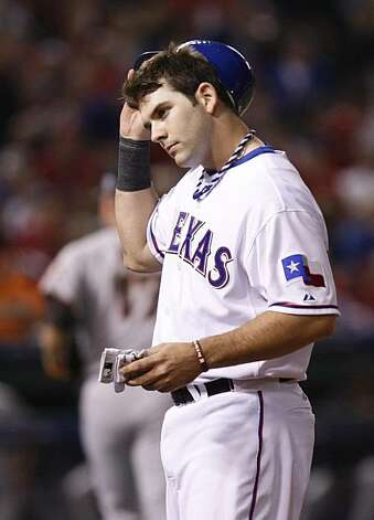 Texas Rangers' Mitch Moreland removes his helmet and batting gloves in Game 5 of the World Series against the San Francisco Giants on Monday. Photo: Lance Iversen, San Francisco Chronicle