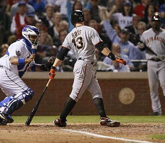 Texas Rangers catcher Bengie Molina makes the tag on San Francisco Giants center fielder Cody Ross in the fourth inning of Game 5 of the World Series on Monday. Photo: Lance Iversen, San Francisco Chronicle