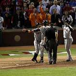 San Francisco Giants shortstop Edgar Renteria is greeted at home plate by Cody Ross and Juan Uribe after Renteria's three-run home run in the seventh inning of Game 5 of the World Series against the Texas Rangers on Monday.