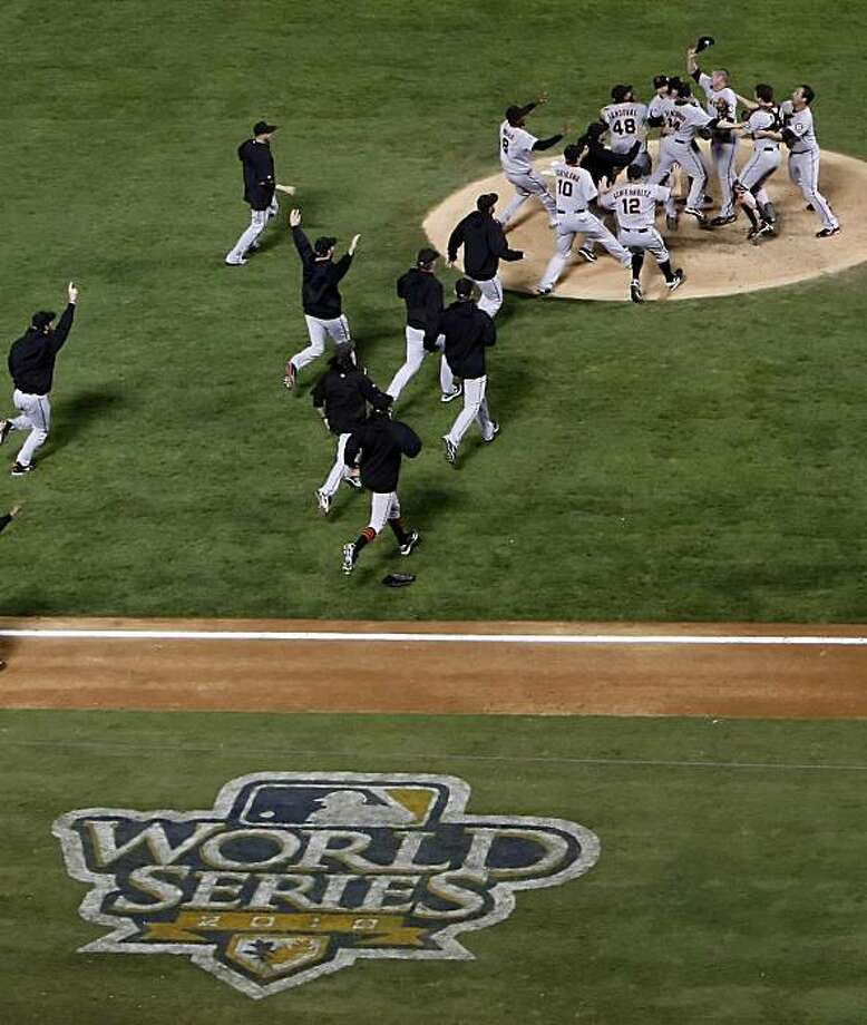 The Giants celebrate on the field after winning the final game of the World Series.The San Francisco Giants defeated the Texas Rangers 3-1 in Game 5 of the World Series at Rangers Ballpark in Arlington, Tx, on Monday, November 1, 2010. Photo: Carlos Avila Gonzalez, San Francisco Chronicle