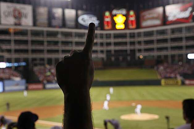 A Texas Rangers fan shows his support for his team at Game 5 of the World Series against the San Francisco Giants at Rangers Ballpark on Monday. Photo: Lea Suzuki, San Francisco Chronicle