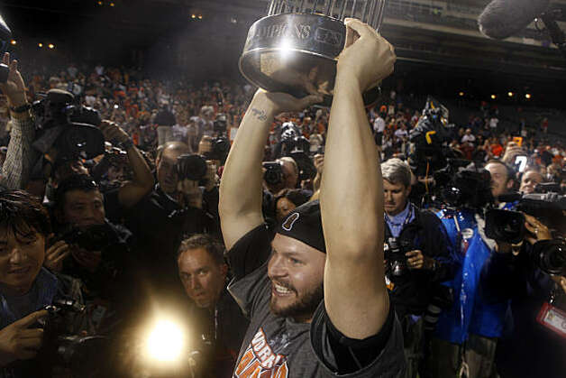 San Francisco Giants' Cody Ross (13) lifts the 2010 World Series Championship trophy over his head on the field at Rangers Ballpark after the San Francisco Giants win Game 5 of the World Series over the Texas Rangers 3-1 on Monday November 1, 2010 in Arlington, Texas. Photo: Lea Suzuki, San Francisco Chronicle