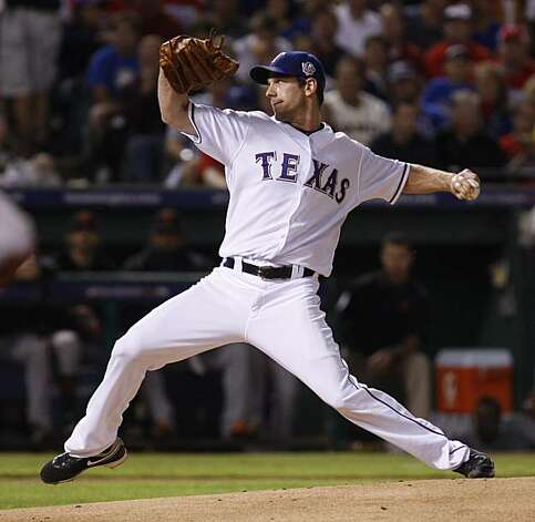 Texas Rangers starting pitcher Cliff Lee throws a pitch in the first inning of Game 5 of the World Series against the San Francisco Giants on Monday. Photo: Lance Iversen, San Francisco Chronicle