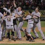 Aubrey Huff celebrates with the team as the San Francisco Giants take Game 5 to win the World Series over the Texas Rangers on Monday.