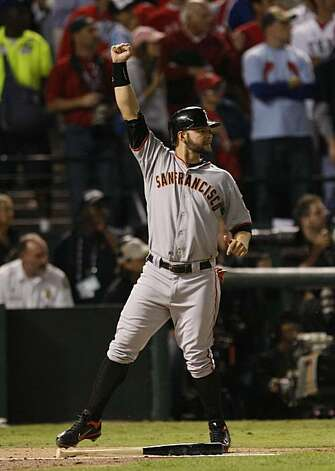 San Francisco Giants center fielder Cody Ross (13) celebrates as he scores on Edgar Renteria's three-run home run in the seventh inning during game 5 of the 2010 World Series between the San Francisco Giants and the Texas Rangers on Monday, Nov. 1, 2010 in Arlington, Tx. Photo: Lance Iversen, San Francisco Chronicle