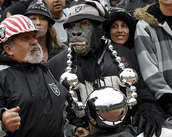 A fan dressed as a gorilla is one of the regulars in the Black Hole. The Oakland Raiders defeated the Kansas City Chiefs 23-20 in overtime Sunday. Photo: Brant Ward, The Chronicle