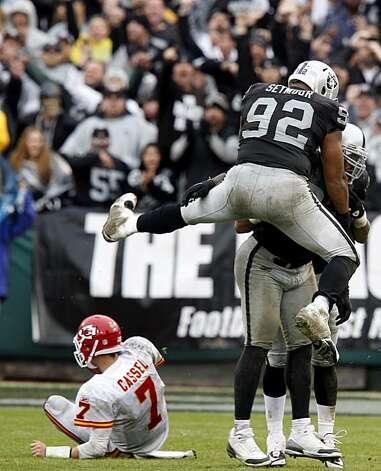 Raiders linemen celebrate the sacking of Chiefs quarterback Matt Cassel in the second half in Oakland on Sunday. Photo: Brant Ward, The Chronicle