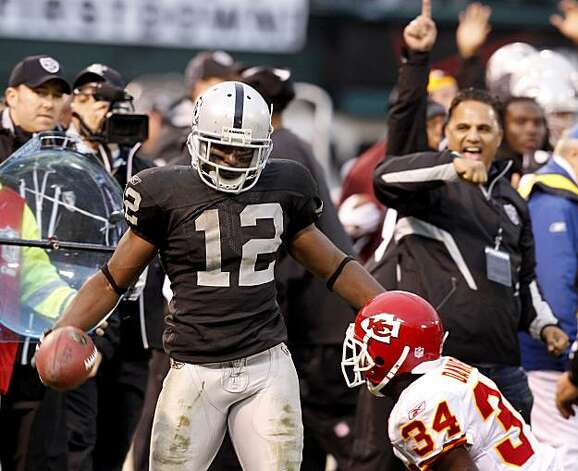 The Raiders' Jacoby Ford stares down at Chiefs defender Travis Daniels after a big gain in the second half in Oakland on Sunday. Photo: Brant Ward, The Chronicle