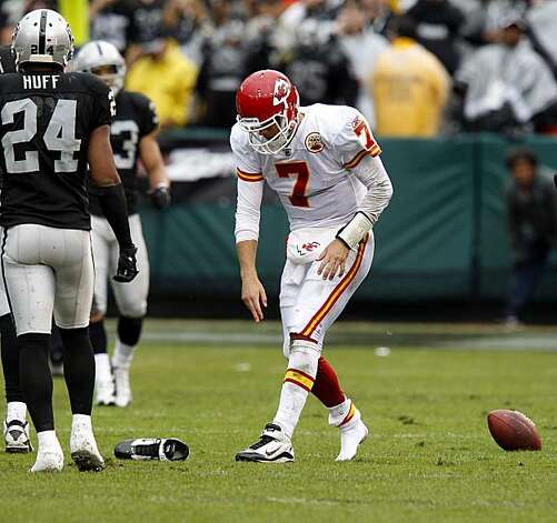 Chiefs quarterback Matt Cassel goes back to get his shoe after a run in the first half in Oakland on Sunday. Photo: Brant Ward, The Chronicle