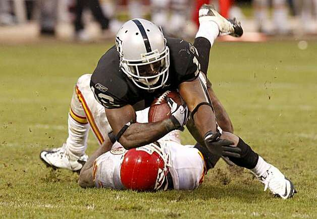Jacoby Ford's reception in overtime sets up the Raiders' winning field goal against the Kansas City Chiefs in Oakland on Sunday. Photo: Brant Ward, The Chronicle