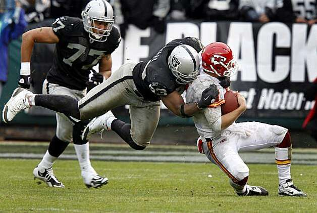 Chiefs quarterback Matt Cassel is sacked by Tommy Kelly in the second half on Sunday. Photo: Brant Ward, The Chronicle
