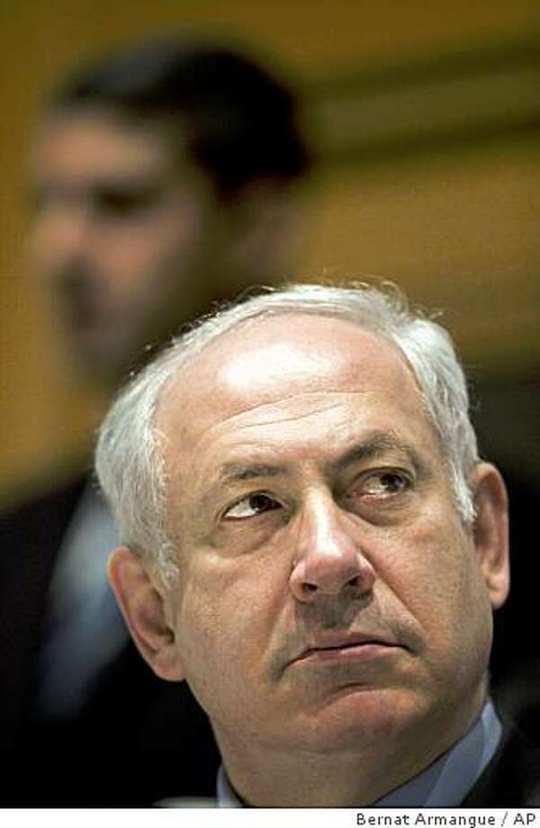 """Israel's Prime Minister designate Benjamin Netanyahu looks on during an economic conference in Jerusalem, Wednesday, March 25, 2009. Netanyahu on Wednesday promised to resume peace talks with the Palestinians after he takes office, saying his government will be a """"partner for peace."""" (AP Photo/Bernat Armangue) Photo: Bernat Armangue, AP"""