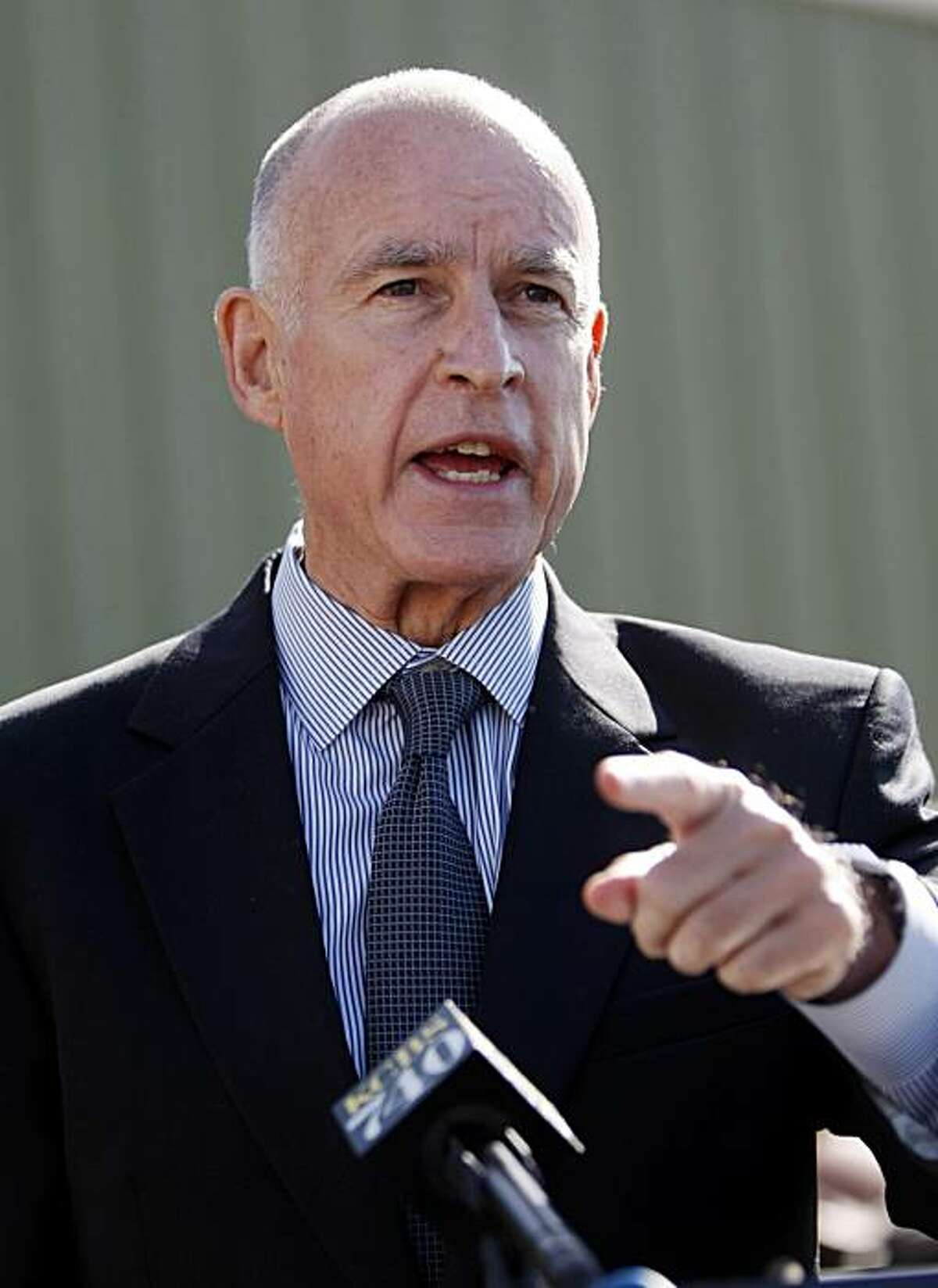 California attorney general and democratic gubernatorial candidate Jerry Brown gestures at news conference at Petersen Dean Roofing and Solar Systems in Newark, Calif., Thursday, Sept. 23, 2010.