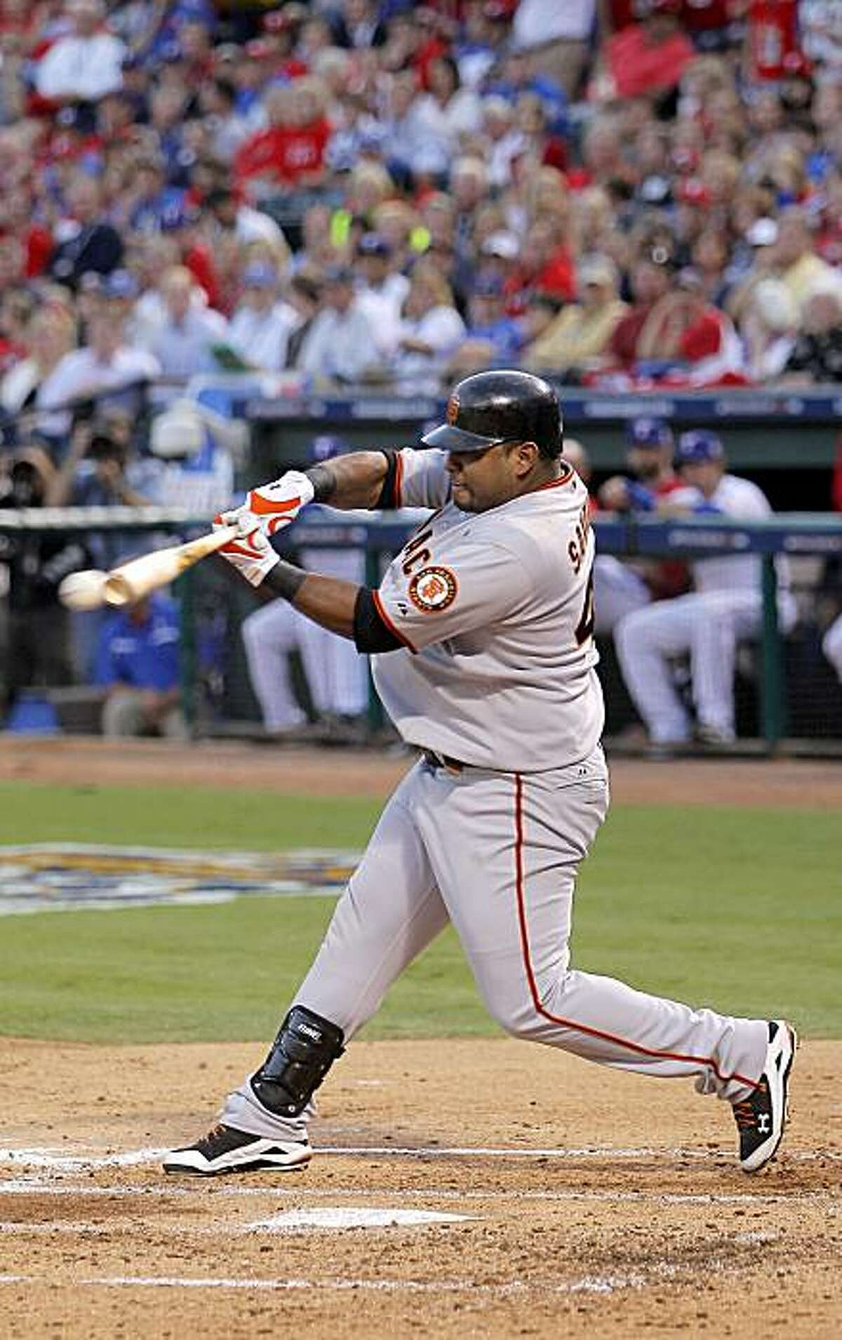 Giants Pablo Sandoval hits into a double play in the second inning, as the San Francisco Giants fall in game 3 by a score of 4-2 to the Texas Rangers, of the 2010 World Series on Saturday Oct. 30, 2010 in Arlington, Tx.