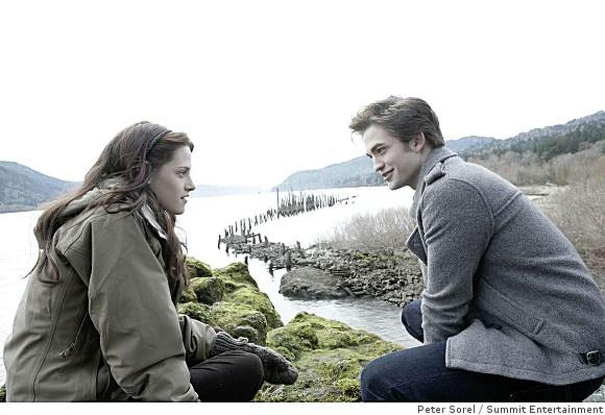 """""""Twilight"""": Edward (ROBERT PATTINSON) walks with Bella (KRISTEN STEWART) to the River?s Edge."""