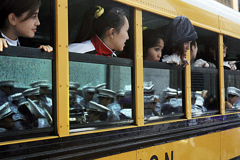 Archbishop Riordan High School's color guard waits on a bus out of the rain for San Francisco's 91st annual Veterans Day Parade to begin on Sunday. Photo: Adm Golub, The Chronicle
