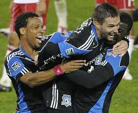 San Jose Earthquakes' Bobby Convey, center, celebrates with Scott Sealy, left, and Brandon McDonald after the Earthquakes beat the New York Red Bulls 3-1 to win the MLS Eastern Conference semifinal soccer series Thursday, Nov. 4, 2010, in Harrison, N.J.